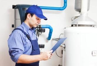 Technician Servicing an Hot-Water Heater Sunrise